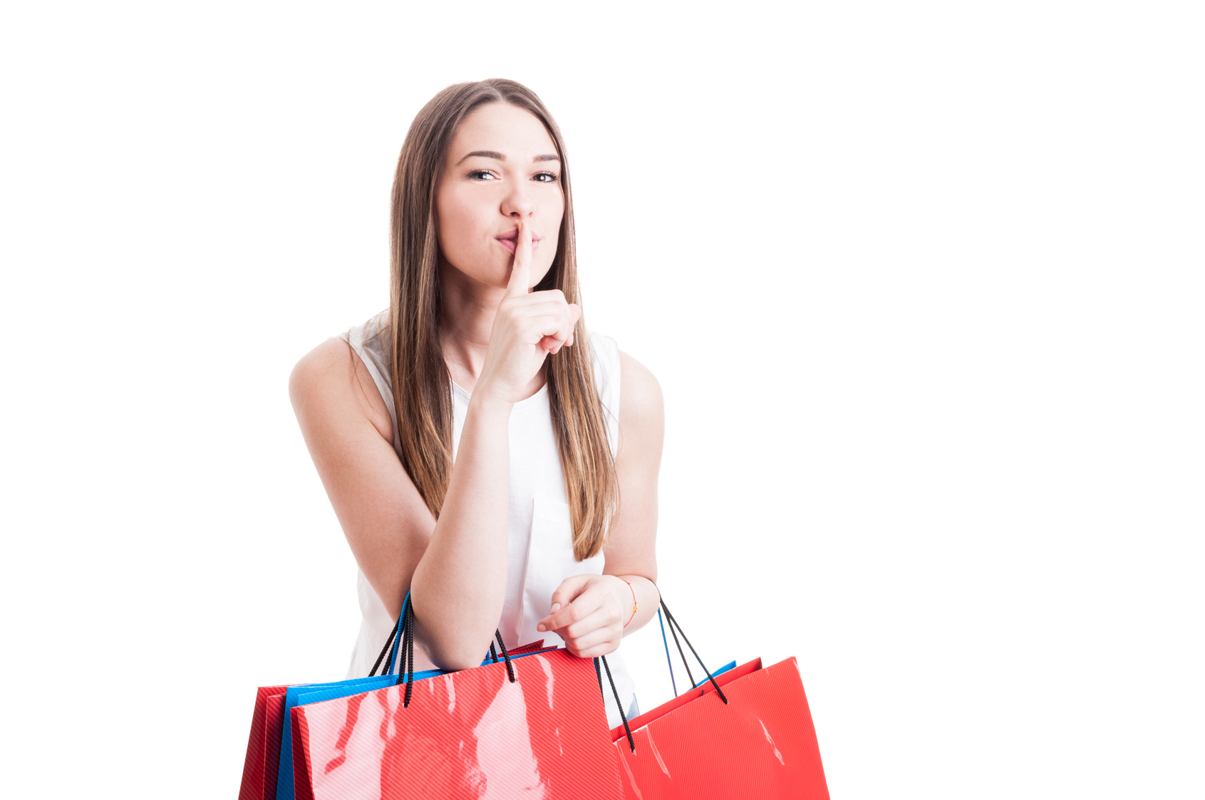 Attractive pretty shopaholic with shopping bags making a silence